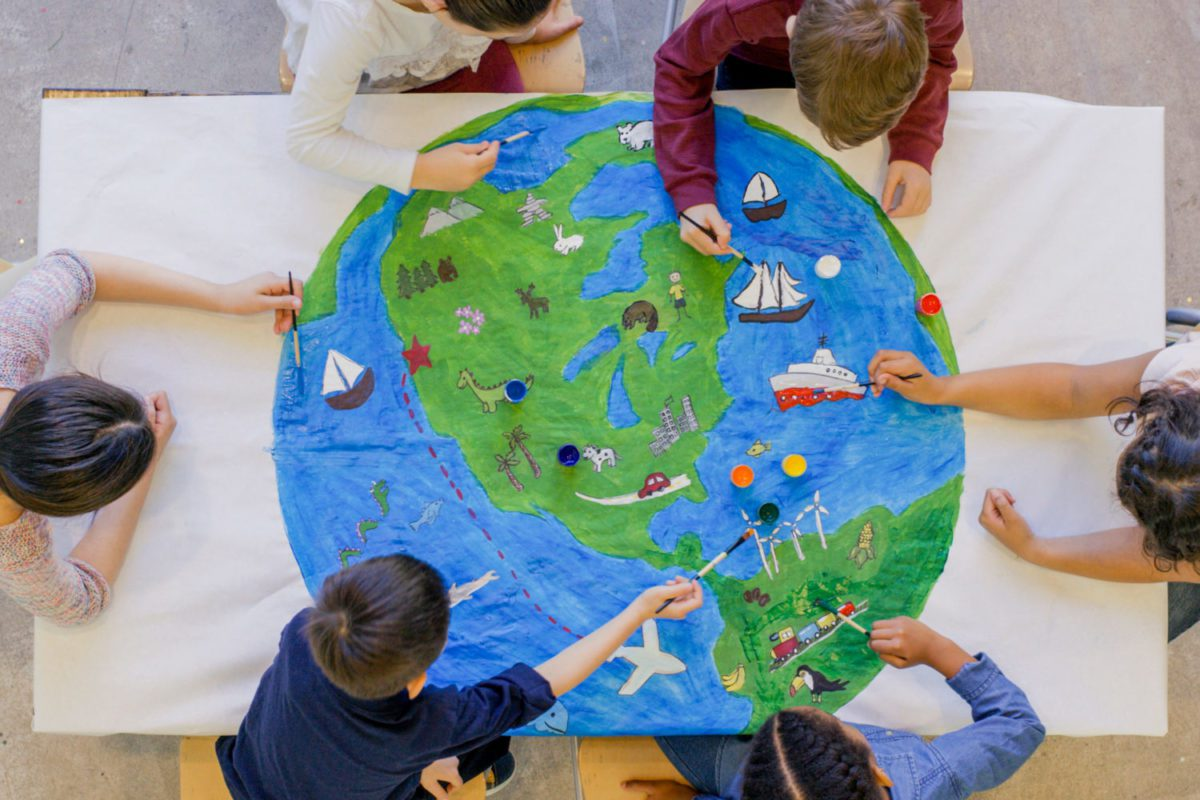 Kids painting globe picture