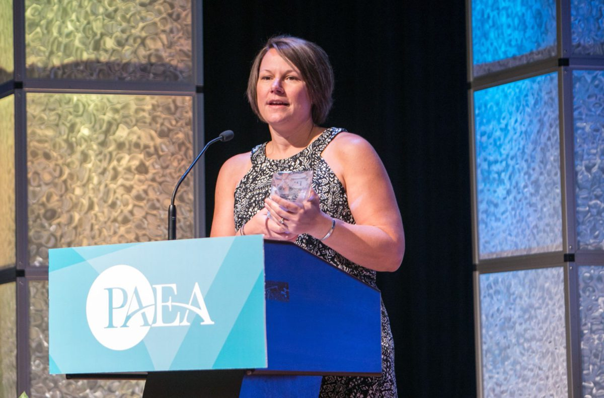 Michelle Ostmoe accepts award for PA education