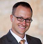 headshot of Bryan Husk