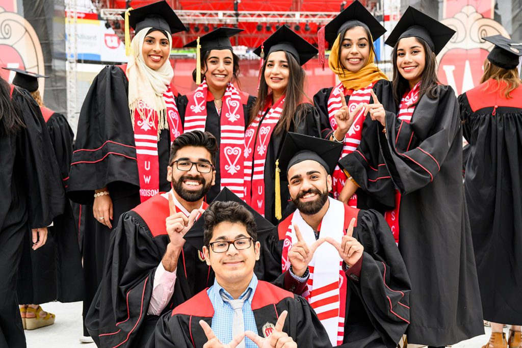 A group of graduates display their Badger pride during UW-Madison's spring commencement ceremony at Camp Randall Stadium at the University of Wisconsin-Madison