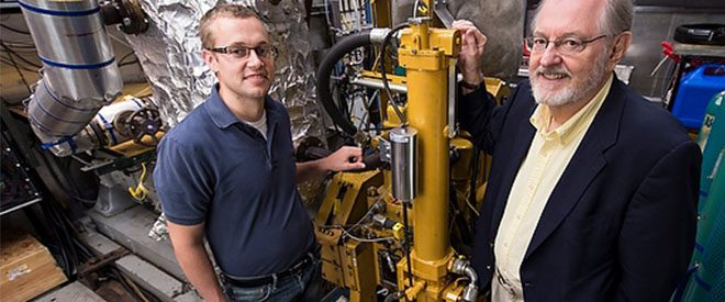 Engine Systems student standing with professor