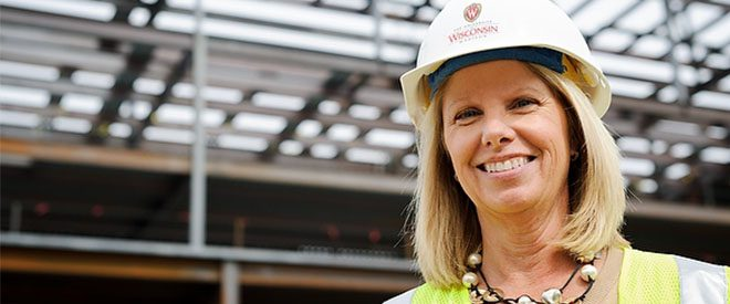 Happy engineering manager wearing UW–Madison hard hat