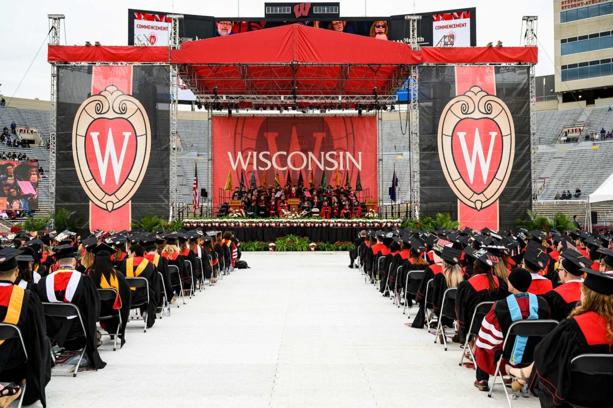 stage at 2019 uw-Madison graduation, surrounded by seated students ready to graduate
