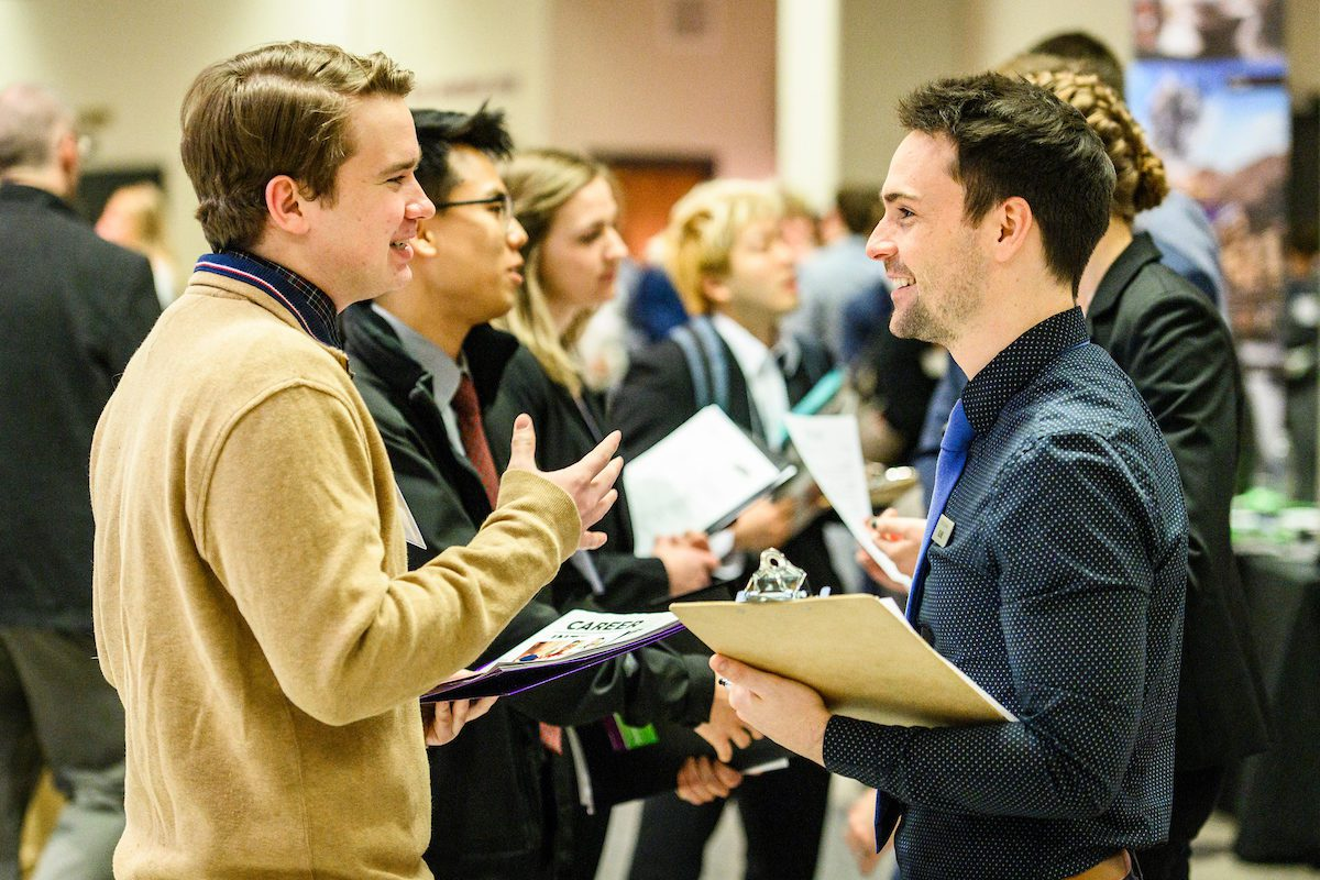 Undergraduate Kevin Lussky (left) talks with a recruiter from Uline during the annual Spring Career and Internship Fair held at the Kohl Center at the University of Wisconsin-Madison on Feb. 5, 2019. The fair featured 215 employers and was open to all current students and alumni.