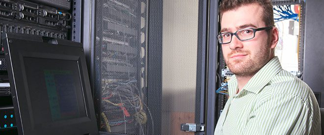 data scientist sits in front of a computer